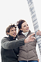 Germany, Baltic Sea, Lübecker Bucht, Young couple on sailing boat, portrait - BAB00385
