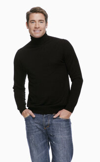 Young man in jeans and pullover, portrait - KMF01088