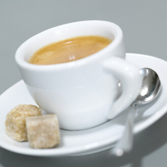 Cup of Espresso and brown sugar cubes. close-up - CHKF00474