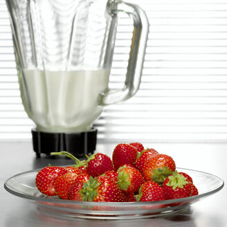 Strawberries in front of mixer, close-up - CHKF00462