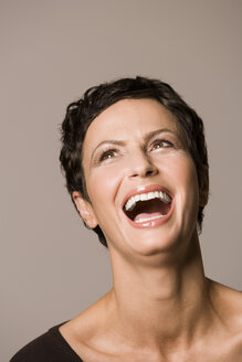 Portrait of a woman, laughing, close-up - RRF00034