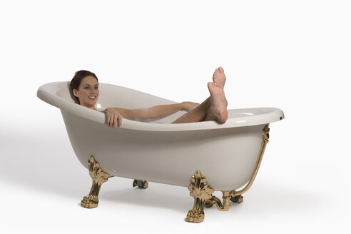 Young woman relaxing in bathtub - RRF00025