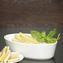 Asparagus and salad in white bowl, close-up - CHK00870