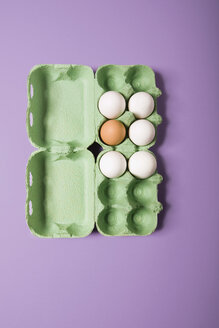 Five white and one brown egg in an egg box, elavated view - MNF00116