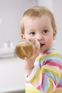 Baby girl (2-3) drinking tea, portrait - SMOF00143