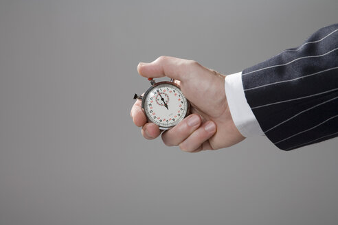 Man holding stop watch, close-up - MAEF00780
