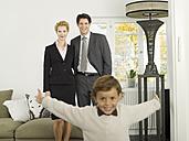 Family standing in livingroom, portrait - WESTF06640