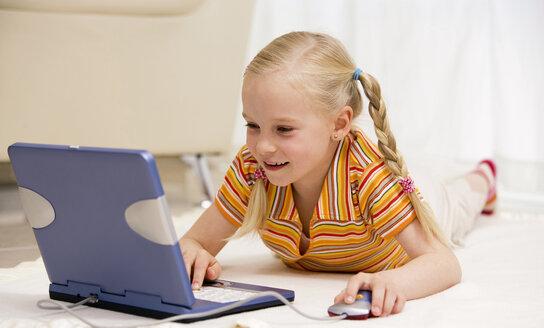 Young girl (10-11) using laptop - HK00039