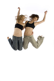 Two young women jumping in mid-air - RRF00123