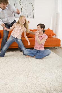 Playful family in living room - WESTF07331