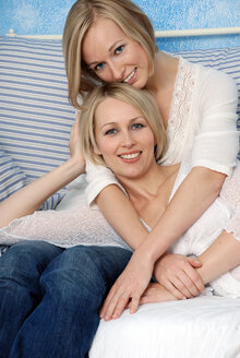 Two blonde women, embracing, relaxing, portrait - DKF00147
