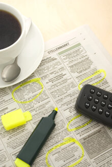 Cup of coffee, newspaper and marker, elevated view - MU00246