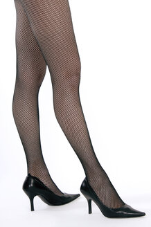 Female legs, High heels and fish net stockings - 00375LR-U