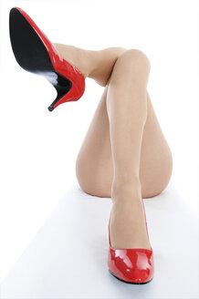 Female legs in high heels, close up - 00372LR-U
