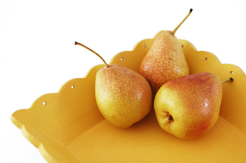 Three pears on a tray, close up - 00369LR-U