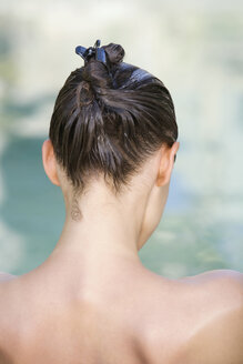 Woman using conditioner, rear view - ABF00234