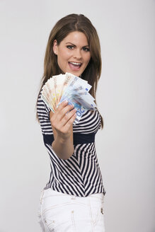 Young woman holding money, portrait - RDF00349