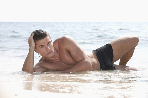 Asia, Thailand, Young man relaxing on beach, portrait - RDF00662