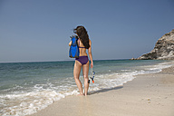 Asia, Thailand, Young woman on beach, rear view - RDF00643