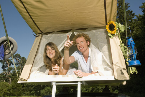 Germany, Bavaria, Young couple laying in tent - RDF00577