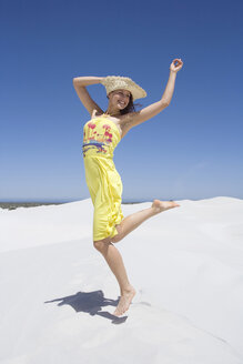 South Africa, Cape town, Young woman in sand dunes - ABF00376
