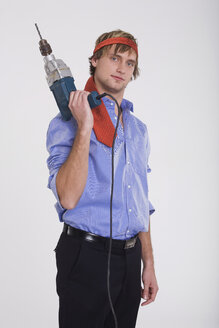 Young man holding a power drill - RDF00820