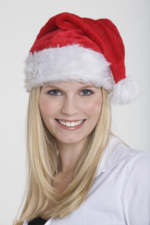 Young woman wearing a Santa Claus hat, portrait - RDF00805