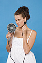 Young woman holding hair blower, portrait - RDF00748