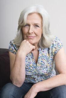 Senior woman, hand on chin, portrait - WESTF08375