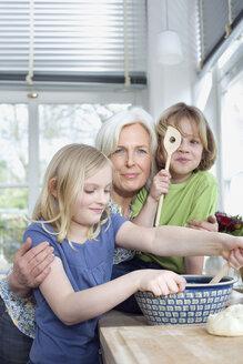 Granddaughter (8-9) mixing dough in bowl, portrait - WESTF08303