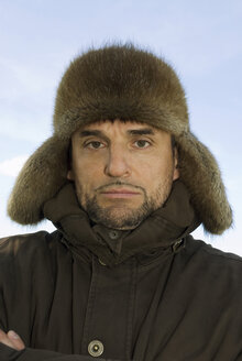 Germany, Bavaria, Man with fur cap, portrait - NHF00778