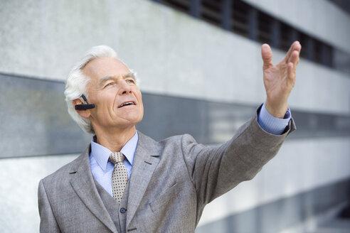 Germany,Baden Württemberg, Stuttgart, Senior Business man wearing headset - WEST08419
