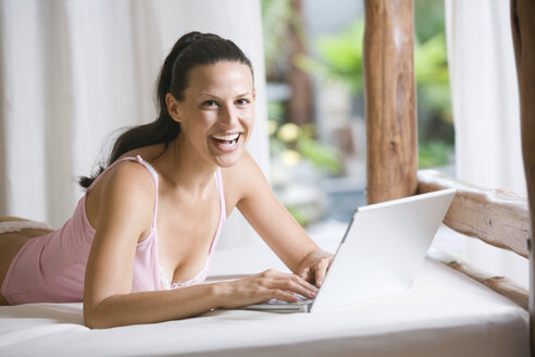 Young woman in underwear using laptop - ABF00348