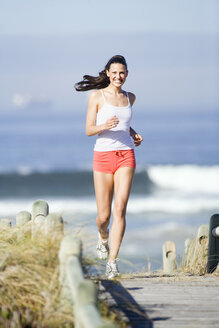 Young woman jogging - ABF00316