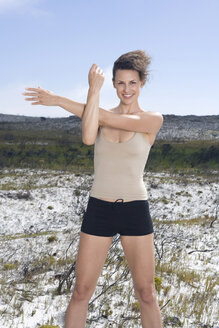 South Africa, Cape Town, Young woman exercising yoga - ABF00299