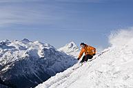 Austria, Salzburger Land, Altenmarkt- Zauchensee, Man skiing - HH02474
