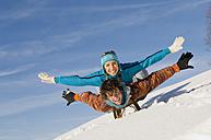 Austria, Salzburger Land, Altenmarkt-Zauchensee, Young couple on sledge - HH02557