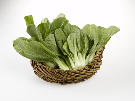 Bok choy, Chinese celery cabbage in basket, close-up - KSWF00173
