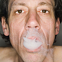 Man exhaling cigarette smoke, close-up, portrait - MUF00571