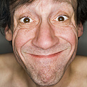 Man pulling funny face, close-up, portrait - MUF00565