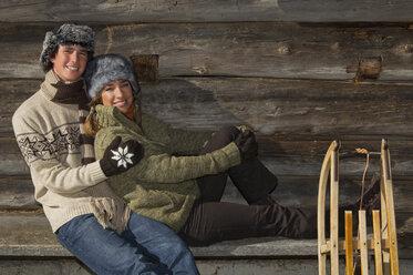 Austria, Salzburger Land, Altenmarkt, Young couple taking a break at cabin - HH02604