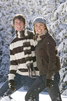 Austria, Salzburger Land, Altenmarkt, Young couple in snowscape, smiling - HH02595