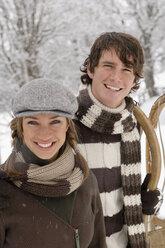 Austria, Salzburger Land, Altenmarkt, Young couple in winter clothes, smiling - HH02589