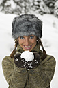 Austria, Salzburger Land, Altenmarkt, Young woman presenting snowball - HH02574