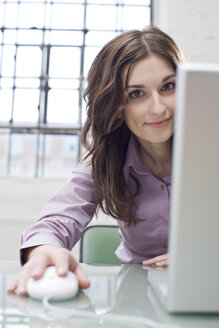 Young businesswoman in office using laptop - BMF00383