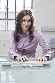 Young businesswoman working in office - BMF00349