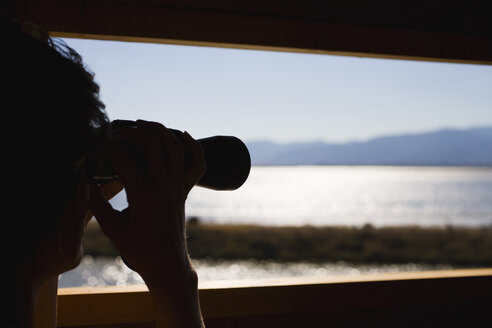 Greece, Lesbos, Person with Binoculars - JRF00066