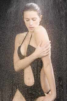 Young woman in swimsuit having a shower, portrait - MAE01026