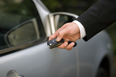 Person at car using remote control key, close-up - GAF00082