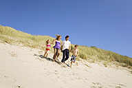 Germany, Baltic sea, Family running down sand dunes - WESTF09352